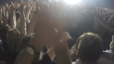 Thousands of young people waving hands at concert. Fans enjoying rock idol show Footage