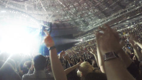 Rock concert atmosphere. Hands of many people applauding in air. Show on stage Footage