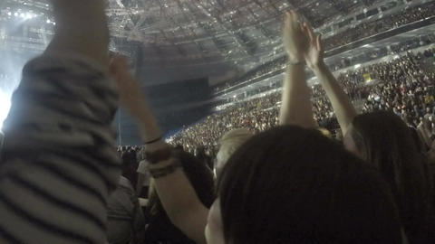 Many fans applauding and dancing at concert of favorite band, enjoying music Footage