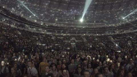 Illumination spots moving on ceiling, light flashing. Crowd enjoying concert Footage