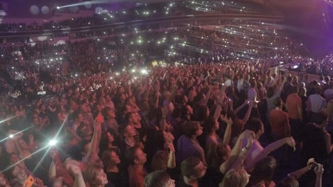 Fans enjoying popular love song at concert, waving mobile phones in air slowly Footage