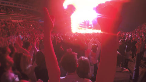 Close-up of hands showing thumbs up during concert. Crowd enjoying celebration Footage