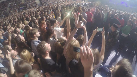 Crowd of young guys filming performance on smartphones. Security guard at work Footage
