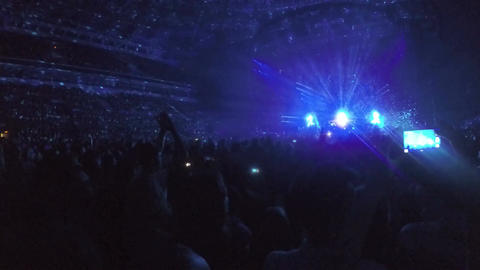 Fantastic light effects in darkness. Fans enjoying performance of music idol Footage