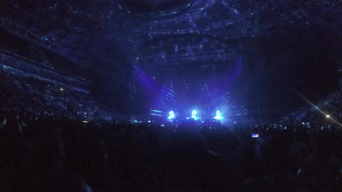 Lights flashing, illumination dots moving on concert arena ceiling. Cool show Footage