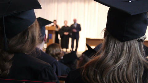 Many young guys listening to headmaster's speech at college graduation ceremony Footage