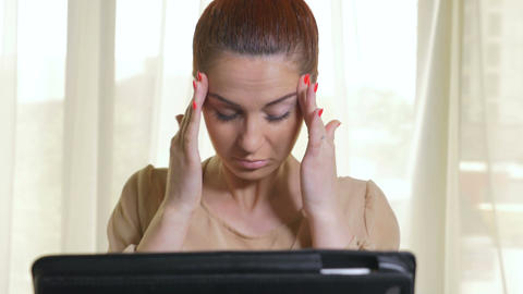 Business woman being tired working on a tablet pc Footage