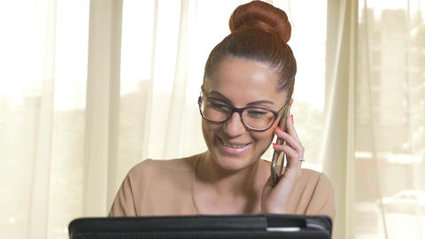 Young attractive business woman answering the phone Footage