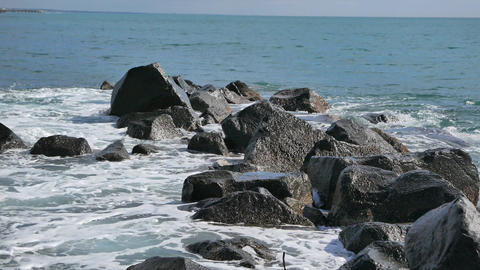 Surf in the rocks. Ostia, Italy Footage