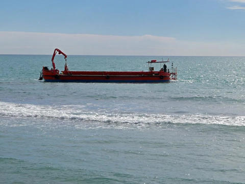 Red barge in the sea. Ostia, Italy ビデオ