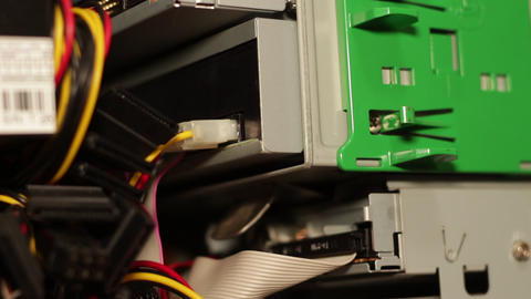 Female hands unhooking the dvd player connector of a desktop pc Live Action