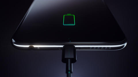 Charging a black smart phone using a cable. Green battery icon. Visualization of Animation