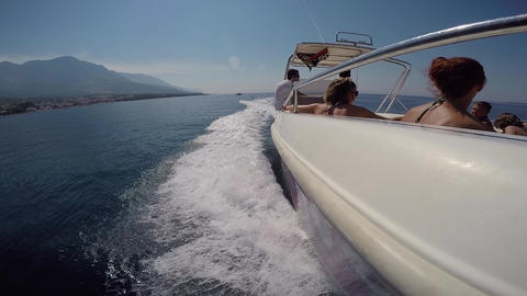 Brela - Croatia - 09-08-2019- Motorboat side parasailing at high speed at Adriatic Sea coast with Live Action