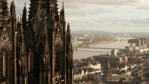AERIAL: Close Up circling around Cologne Cathedral in beautiful Sunlight Live Action