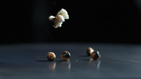 Slow motion of popcorn kernel popping Live Action