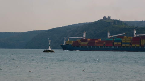 Commercial container freighter at sea. International sea freight transport logistic Live Action
