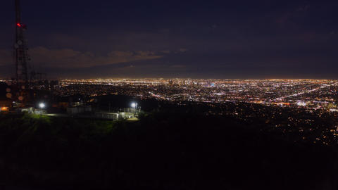 AERIAL HYPER LAPSE: Over Hollywood Sign at Night in Los Angeles, California at Live Action