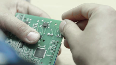 A worker is working on the creation of an electronic…, Live Action