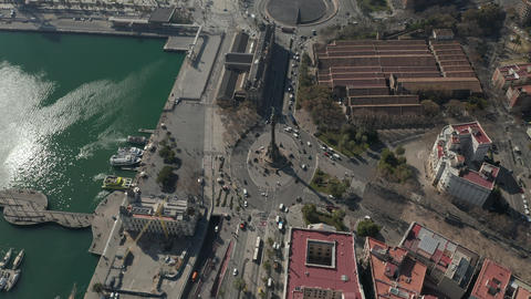 AERIAL: Slow Overhead Flight over Columbus Monument in Barcelona, Spain with Live Action