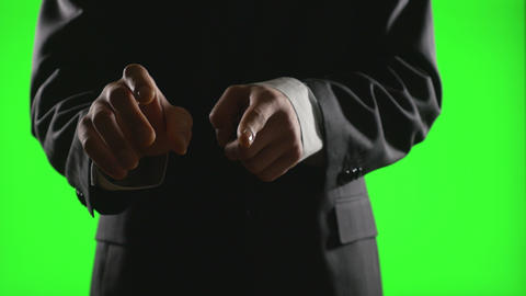 Young businessman making hand gestures in a virtual business environment on gree Footage