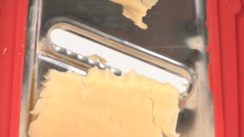 Cheese grater closeup Footage