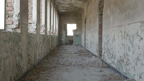 Hooded desperate young man running in an abandoned building Footage