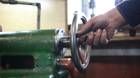 Man hand operating old controls of turning machine Footage