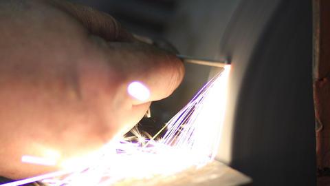 Manual sharpening of tool on grinding machine Footage