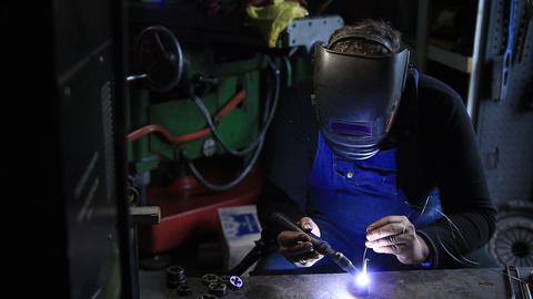 Welder man Tig welding in workshop Footage