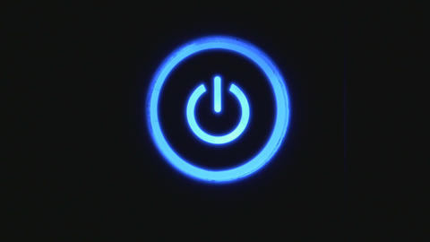 Power button turning on and off on a dark background Live Action