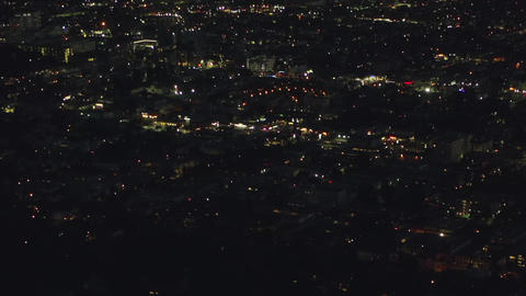 AERIAL: Over Hollywood Hills at Night with view on Downtown Los Angeles view Live Action