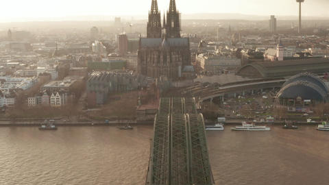 AERIAL: View over Cologne Hohenzollern Bridge and view Cathedral and TV Tower in Live Action