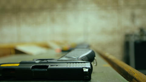 Man picked up a 9mm pistol and shoots in shooting range Live Action