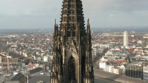 AERIAL: Close Up of Cologne Cathedral two brown Towers in beautiful Sunlight Live Action