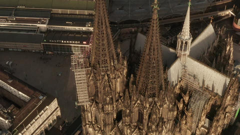 AERIAL: Close Up Overhead Shot of Cologne Cathedral two brown Towers in Live Action