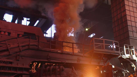 Gas cutting of steel pipes metal factory interior. Sparks flying steel pipes Live Action