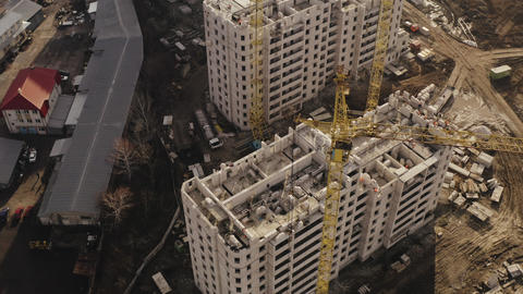 Top view of construction cranes and process of constructing new high-rise Live Action