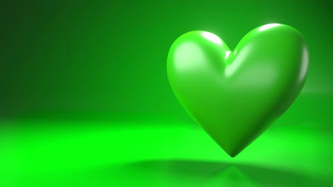 Pulsing green heart shape object on green text space Animation
