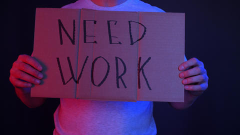 Man holding cardboard with need work inscription GIF