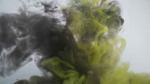 Abstract smoke curls and paint swirling underwater. Abstract background Live Action