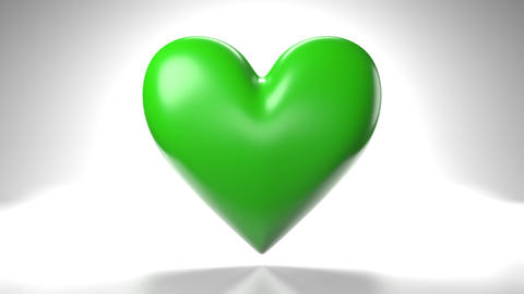 Pulsing green heart shape object on white background Animation