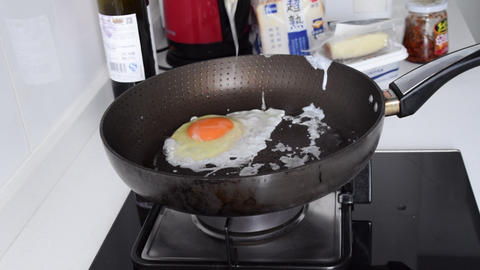 Fried Egg , Egg Sunny side up getting cooked in Pan , cooking egg in pan Live Action