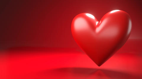 Pulsing red heart shape object on red text space Animation