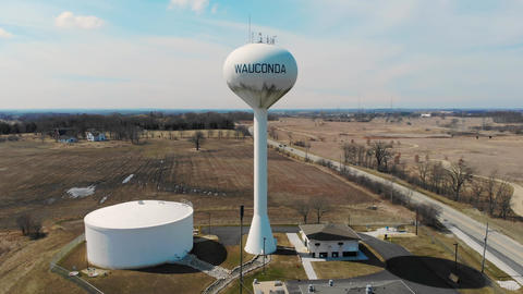WAUCONDA WATER TOWER. Flying over the largest water storage tower from lake Live Action