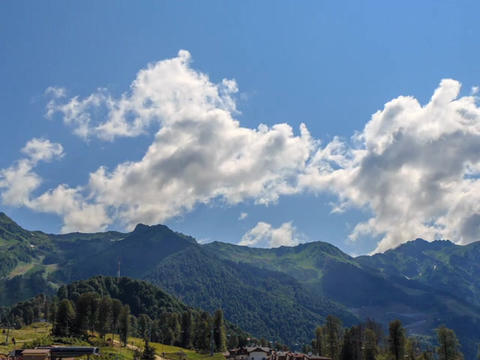 Clouds over the Rosa Khutor Plateau. HDR, Sochi, Russia. Time Lapse Live Action
