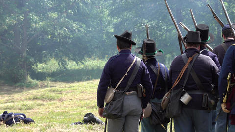 Civil War soldiers shooting across battlefield Footage