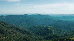 Panorama of beautiful mountain range in summer, green downhills, windy weather Footage