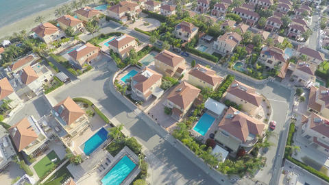 Top view of houses with swimming pools for rent. Vacation at resort. Aerial Footage