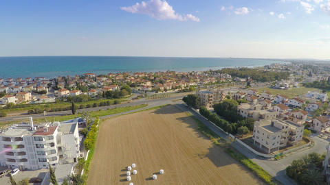 Aerial shot of luxury villas along coastline. Blue sky, sunny day, summer resort Footage