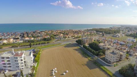 Aerial shot of luxury villas along coastline. Blue sky, sunny day, summer resort Footage
